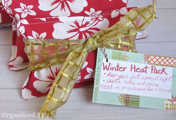 winter heat pack rice packs with a bow and a tag.
