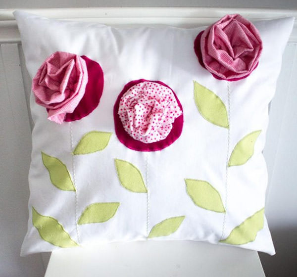cute pillow with pink flowers made with kid's clothes. gift for mom