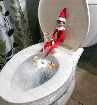 elf on the shelf ice fishing in toilet