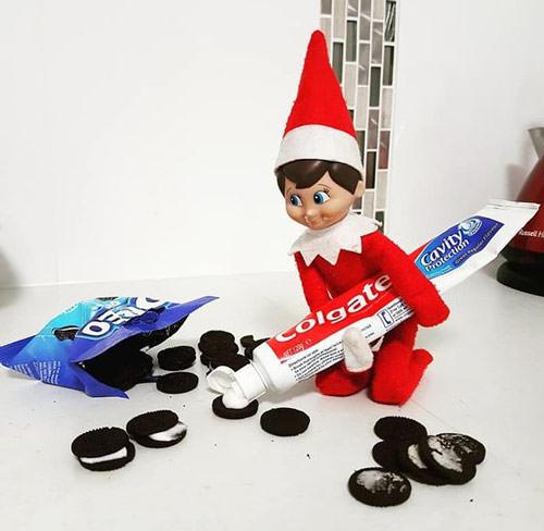 elf on the shelf putting toothpaste in oreos