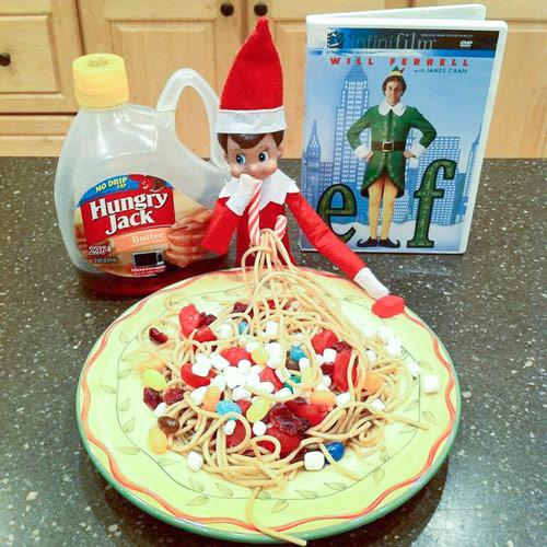 elf on the shelf eating elf spaguetti with elf movie night.