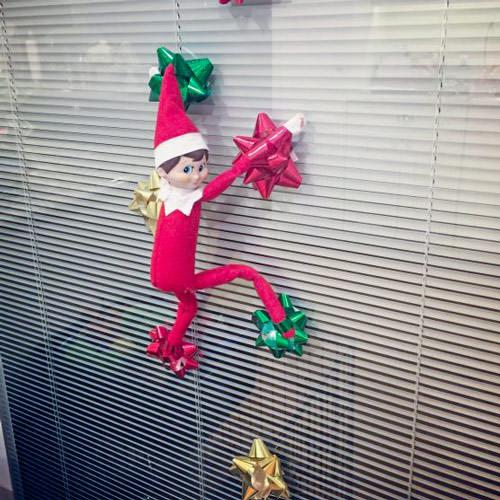 elf on the shelf climbing on bows funny idea