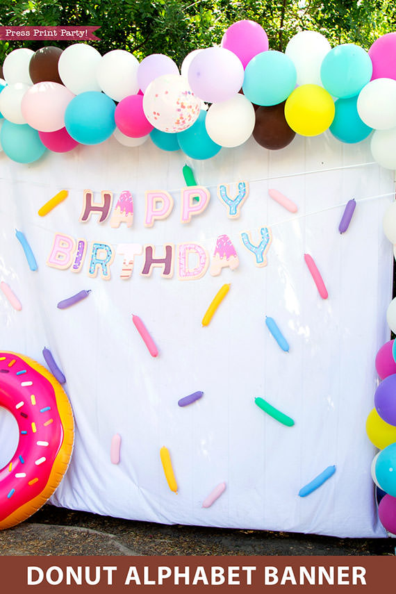 Happy birthday donut birthday alphabet banner garland. photo booth with balloons and inflated donut balloon. Press Print Party!