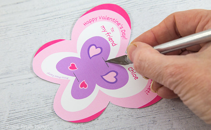 Cutting the slit on the butterfly lollipop card with an xacto knife