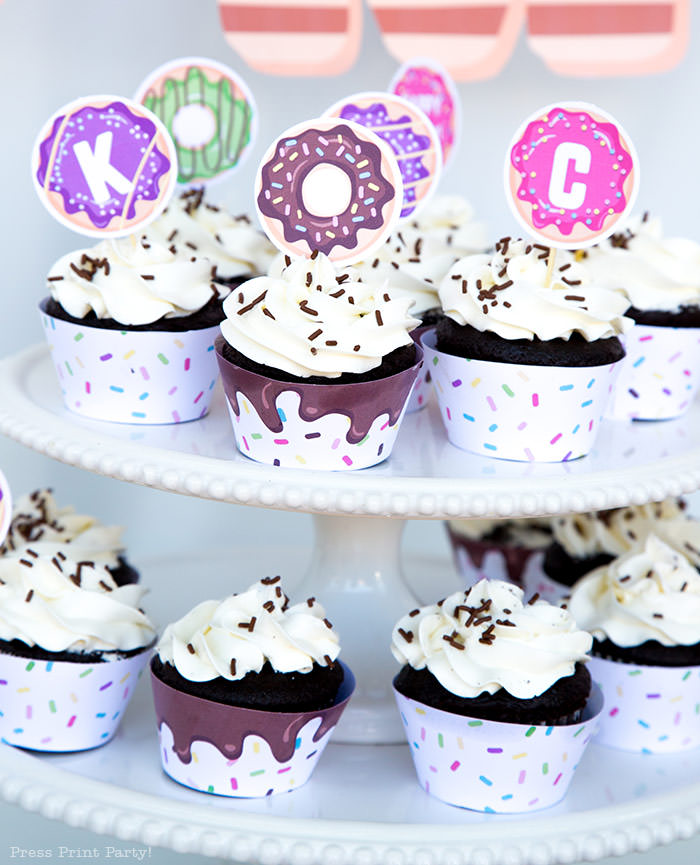 donut party ideas. cupcakes with donut cupcake wrappers and toppers with sprinkles. Press Print Party donut party supplies