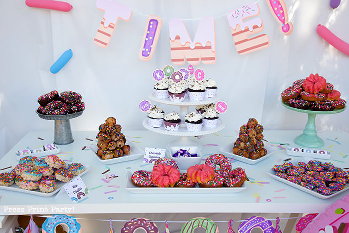 Donut party dessert bar table with all our favorite donuts - Press Print Party