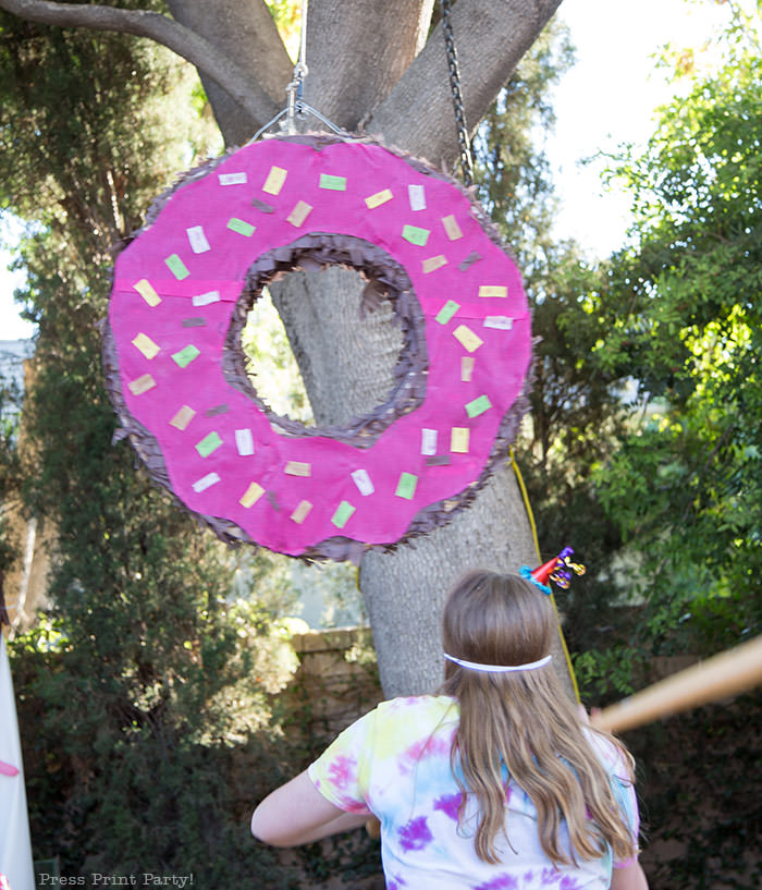 homemade donut pinata with cardboard for donut birthday party - Press Print Party