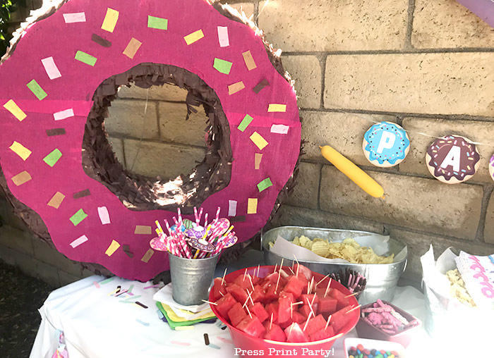 homemade donut pinata on snack table. Press Print Party