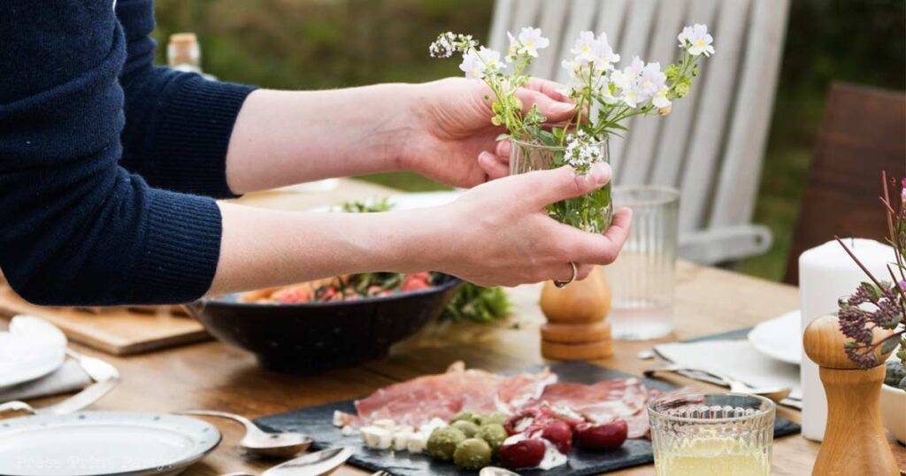 Woman setting dinner table - 15 fancy appetizers quick - Press Print Party!